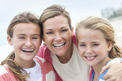 Mom and Daughters Smiling